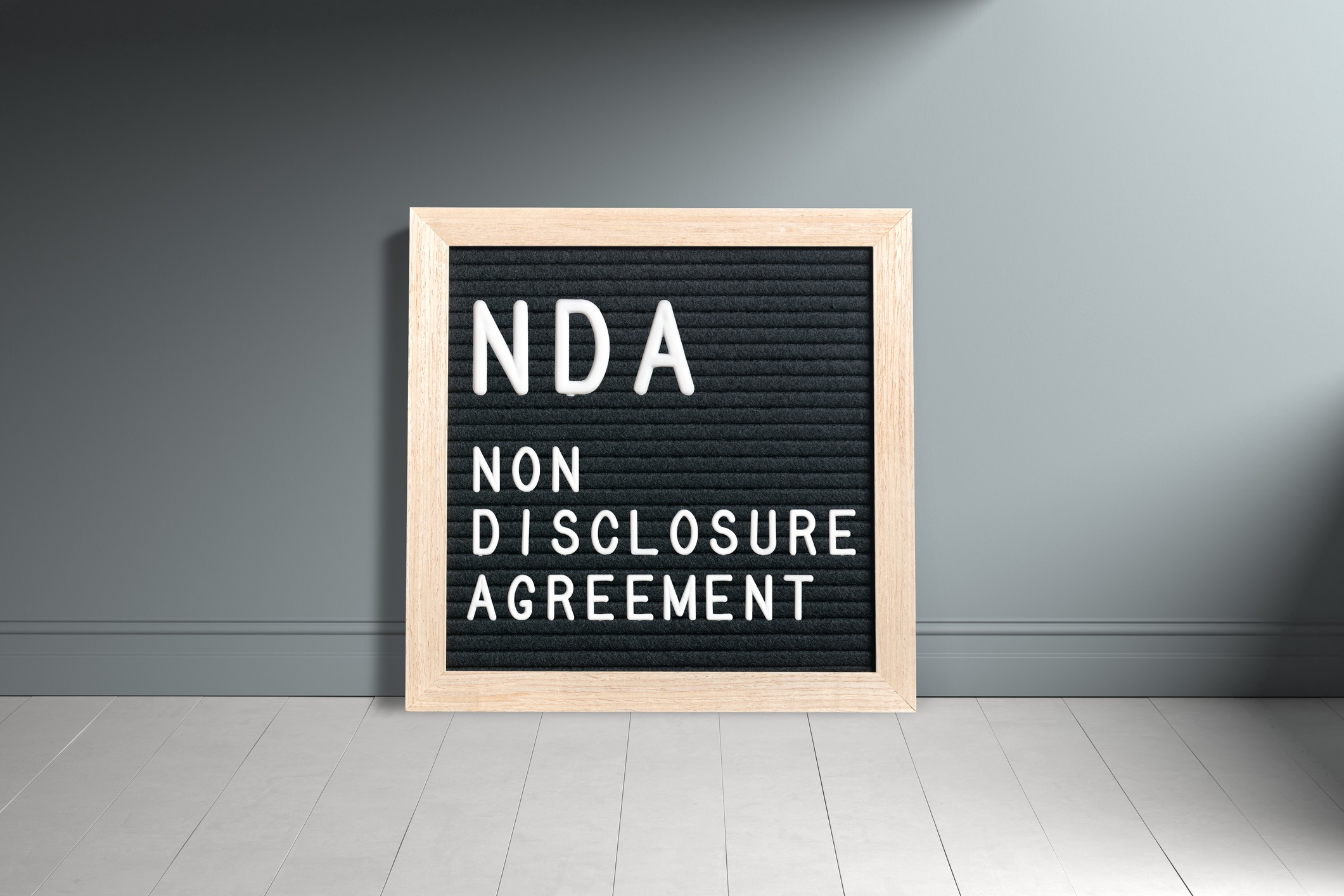 """Letterboard with acronym NDA for """"non disclosure agreement"""""""